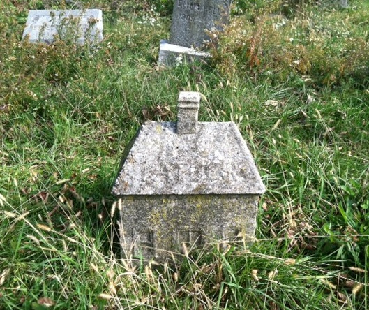 This little house stood out among the other graves and is now one of my favorites. I wonder if the person who it was made for built homes.