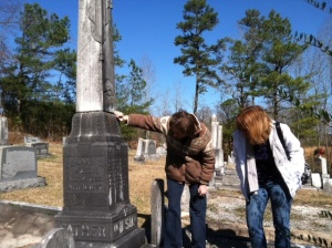 Sarah and Beverly take a look at the inscription on Benjamin Capus Wilson's monument.