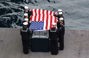 Pallbearers for Cdr. Robert J. Sanderson (Ret.) conduct a burial at sea ceremony in 2004. Photo courtesy of the U.S. Navy.