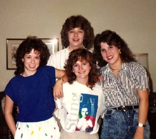 This is me in the 80s in the center of my group of friends. Christi, who I went with me on my first cemetery trip in Omaha, is on the left.
