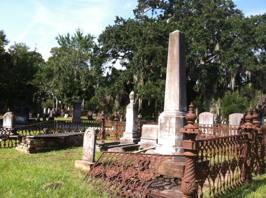 The decaying iron fencing around this family plot is common around Magnolia Cemetery.