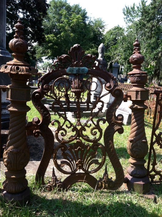 This rusted gate stands sentry over loved ones from the past.