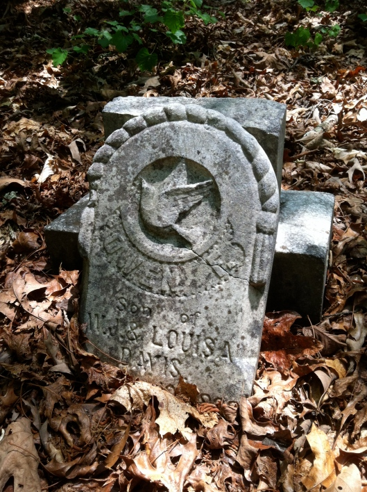 This broken monument features a dove motif, a symbol of peace. It was carved for a child.