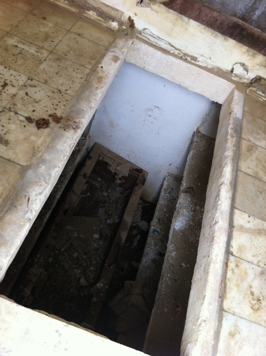 """""""Detail of the abandoned crypts. Looks like """"bunkbeds"""" to rest the coffins on. A very disturbing photo indeed. Did the family take the bodies and relocate them? I hope that is the case."""""""