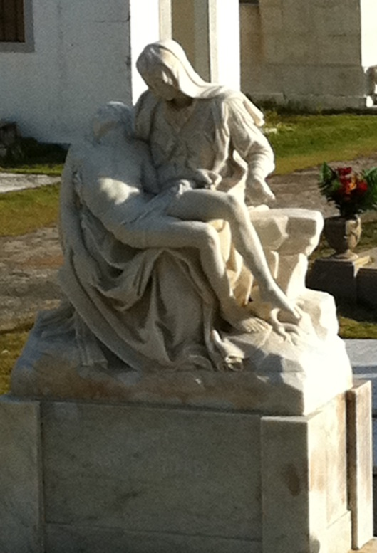 The Pieta is one of the most common statuary depictions.