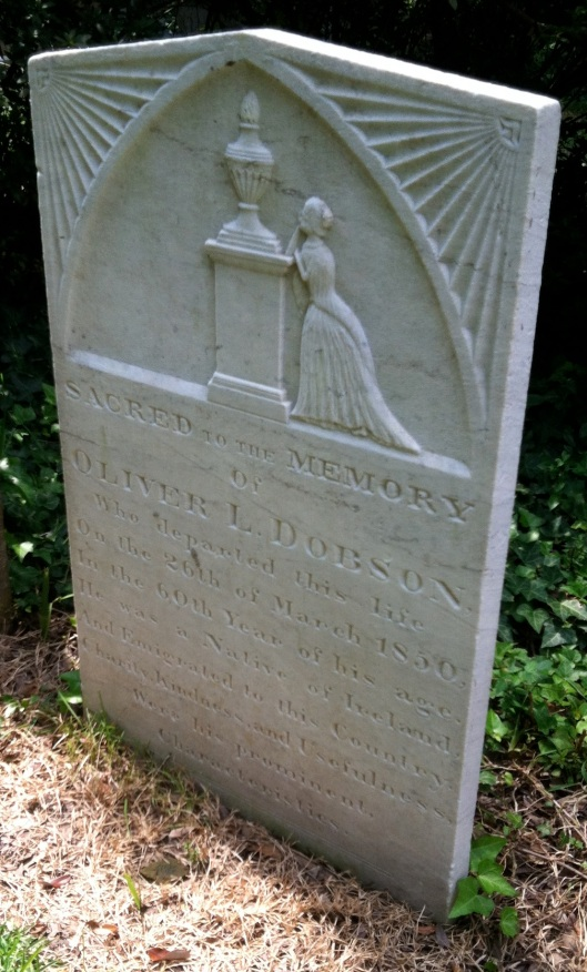 Oliver Dobson's grave exemplifies the Victorian age in which religion was no longer the most prevalent them.