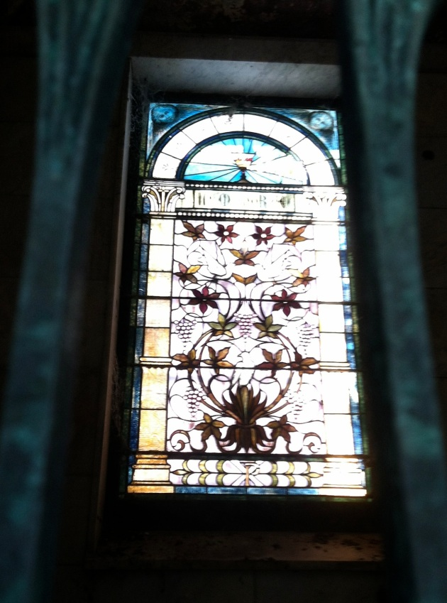 The intricate design of the stained glass panel inside the tomb is indicative of the late 1800s and turn of the century arts.
