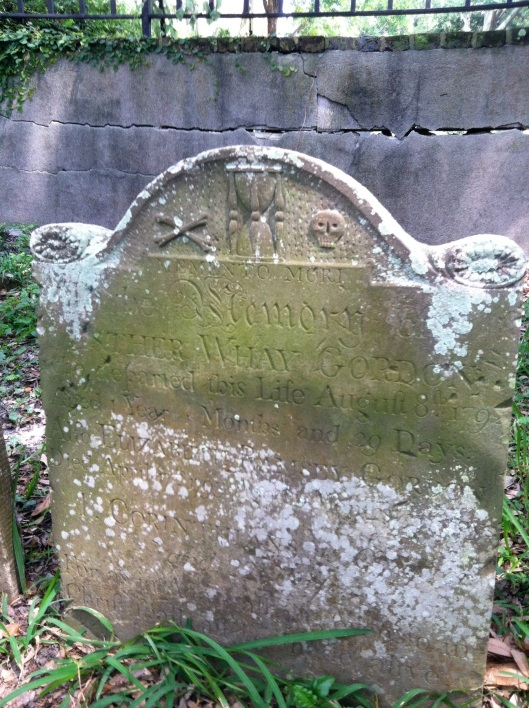 The headstone of infant Esther Whay Gordon features crossed bones, an hourglass and a skull. She died in 1792, having lived only one  year, four months and 29 days. She is buried in the Circular Congregational Church Burial Grounds.