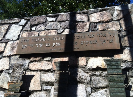 "This metal plaque is inscribed in both English and Yidish. ""For these I weep..."" Is from Lamentations 1:16 of the Old Testament."