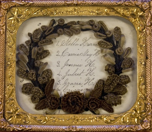 This framed wreath is made out of hair from the ladies listed inside of it. Photo courtesy of Leila' Hair Museum.