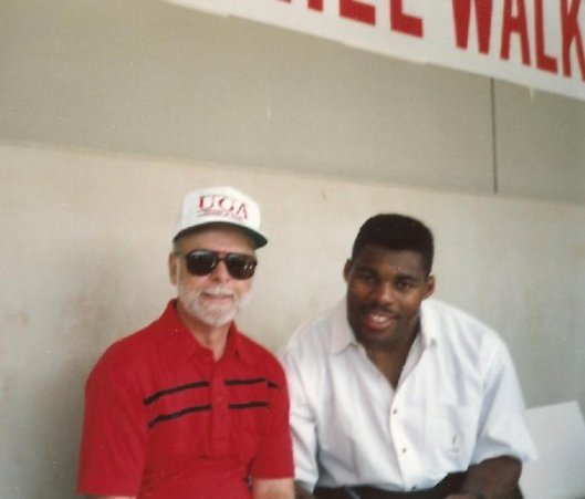 Dad and his idol, Heisman Trophy winner Herschel Walker.