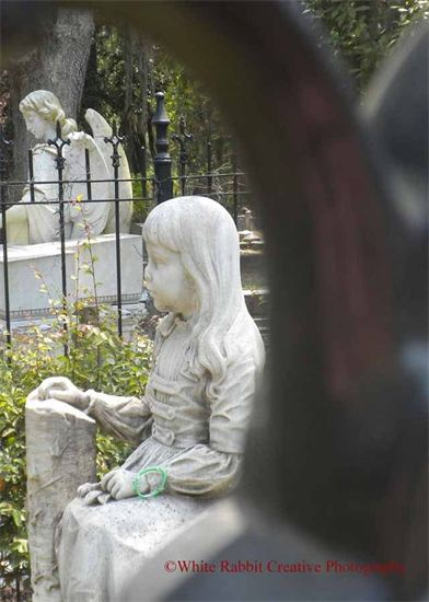 Jennifer Graham's picture of little Grace Watson at Bonaventure Cemetery in Savannah, Ga. serves as the logo of her business, White Rabbit Creative Photography.