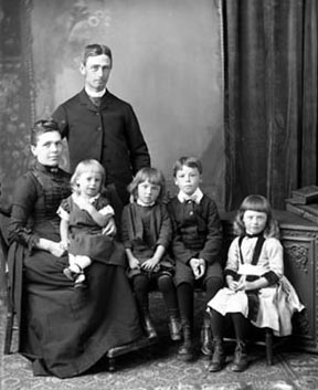 The identity of this group is unknown but they represent the typical family of a Victorian-era minister (or vicar in Britain) and his family. If a wife died young, who would care for her children?