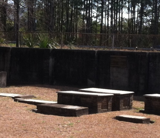 If  you look at the back wall and to the right, you can see one of the memorial plaques listing the names of those thought to be buried there.