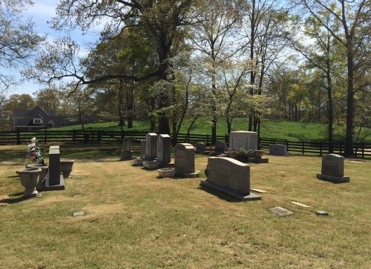 The graves in the Hubbard Family Cemetery range from the 1700s to only a few years ago. You can see Langdon's home in the background.