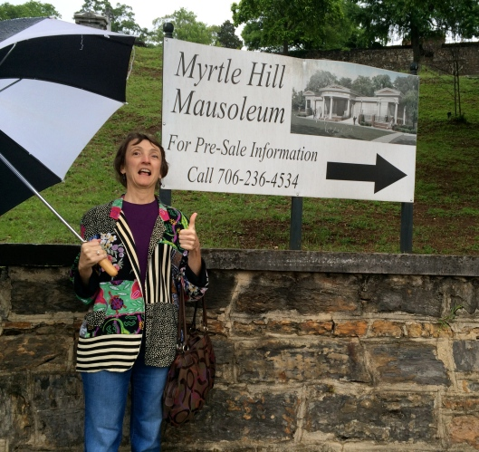Umbrellas were the order of the day during the first half of our hop. Myrtle Hill is still an active cemetery and recently added a new mausoleum, which Sarah gave her thumbs up to.