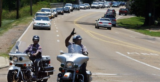 Community Motorized Escort Service of Memphis escorts a funeral procession  for Harrison's Funeral Home Inc. Owner Marcus Eddins said drivers often are distracted and don't notice the man on the motorcycle waving a procession of cars through. Photo courtesy of The Commercial Appeal.