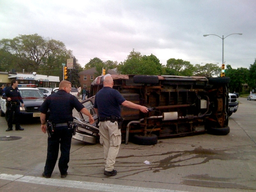 This van, which was traveling in a funeral procession in Milwaukee, Wisc., was overturned when a pickup truck slammed into it. Photo courtesy of Tom Held/Journal-Sentinel.