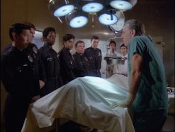 One of my favorite intro scenes on Quincy was when the young police recruits pass out as he begins an autopsy. Photo courtesy of TVRage.