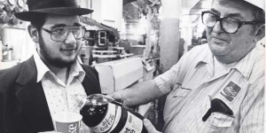 """A bottler pours a taste of """"kosher for Passover"""" Diet Coke for a local rabbi in 1983. During Passover, Coke uses a formula free of corn syrup for its kosher Coke. Photo courtesy of Detroit Free Press/Ira Rosenberg."""