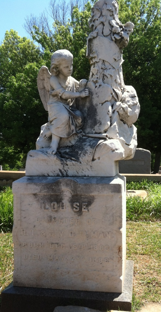 Another cherub leans against a tree on this marker. Louise is buried at Oakland Cemetery in Atlanta, Ga.