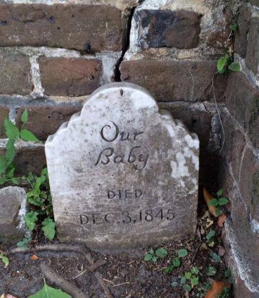 A nameless infant's grave rests in the corner of the Coming Street Cemetery in Charleston, S.C.