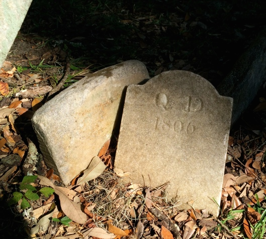 Initials and a date are all that is known about the slave buried here.