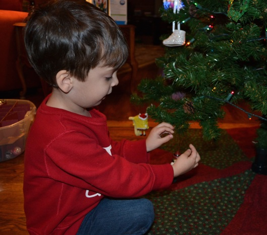 My son decorating our Christmas tree in 2011.