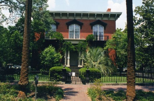 Situated on Monterey Square in Savannah's historic district, the Mercer House is visited by many fans of The Book, hoping to learn more about the murder that happened there. The tour focuses more on Jim Williams' taste in antiques than the Book, however. His sister, June, still lives in the upstairs room (which are off limits to tourists).