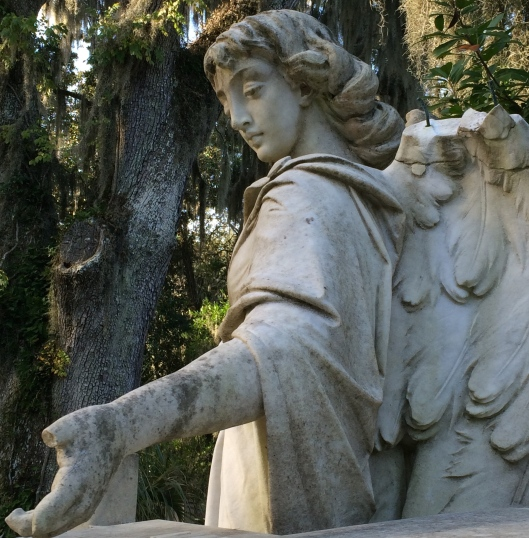 As  you can see, the tops of the angel's wings and her fingers have been damaged over the years. The name of the sculptor is unknown.