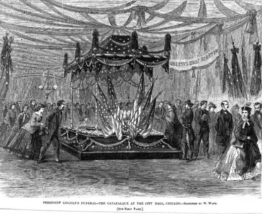 The catafalque used for Lincoln's casket in Chicago's Cook County courthouse was swathed in mourning black and patriotic flags.
