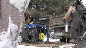 Brothers Matt and Andrew Goeden dig graves with jackhammers and backhoes in Hemming, Minn. Photo courtesy of CNN.