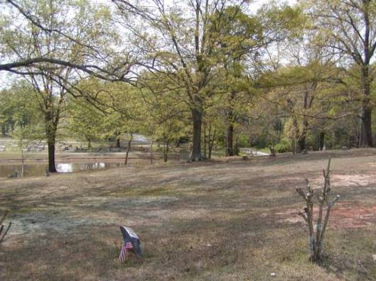 Here's a view from the old cemetery with the pond separating it from the new section. Photo courtesy of www.oldplaces.org.