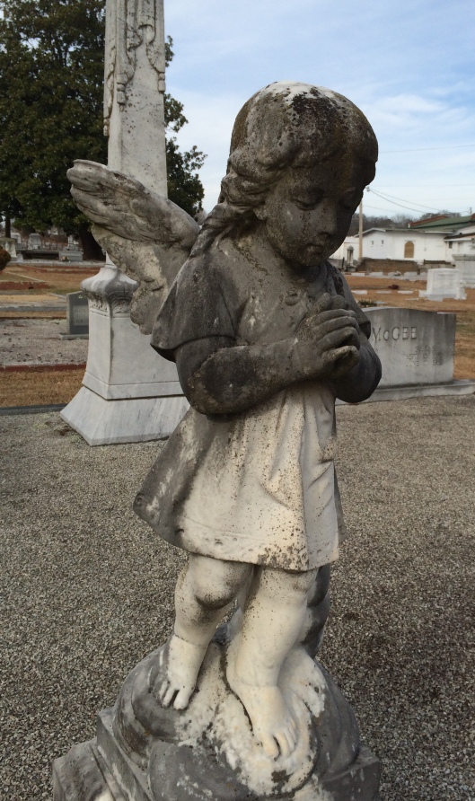 This angel looks a great deal like one I photographed at another cemetery about 30 minutes away.