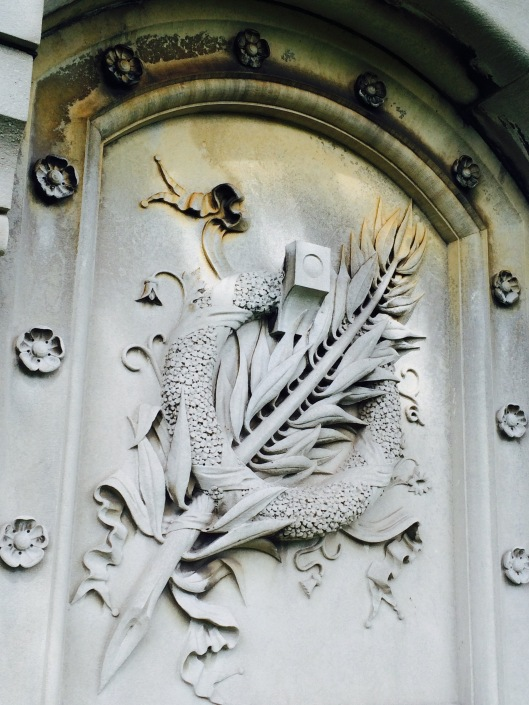 One of the doors features a wreath with a frond through it. Both are often viewed as symbols of victory and immortality.
