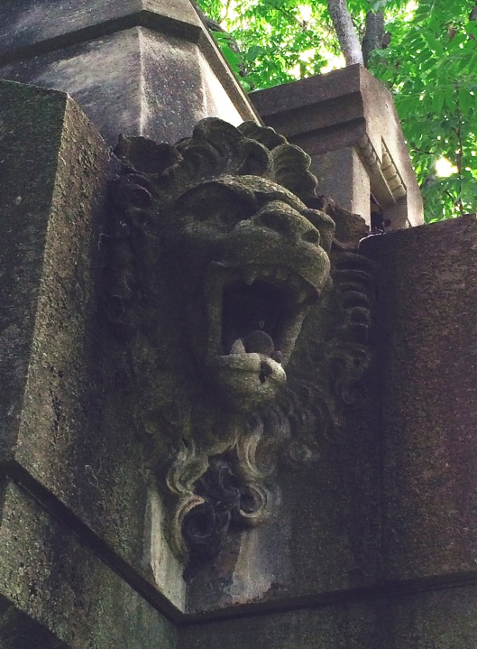 All four corners of the Huck mausoleum are guarded by roaring lions.
