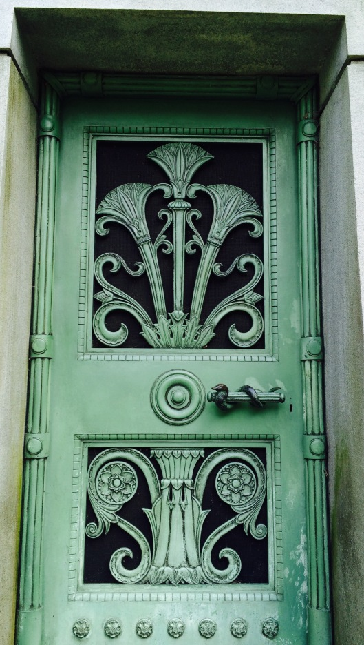 What an ornate door! Can you see what's on the handle?