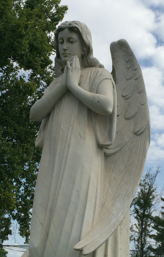 South-View's angel welcomes visitors in front of the cemetery office.
