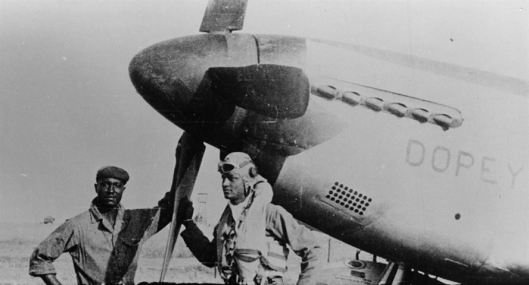 "First Lt. Walter Drake Westmoreland stands with his P-51C, nicknamed ""Dopey"". Photo source: U.S. Air Force"