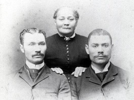 Alonzo Herndon with his mother, Sophenie, and his brother, Thomas, around 1890. Source: The Herndon Home