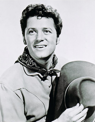 Macrae starred as Curly Maclain in both the broadway production and movie of Rogers & Hammerstein's musical, Oklahoma!.