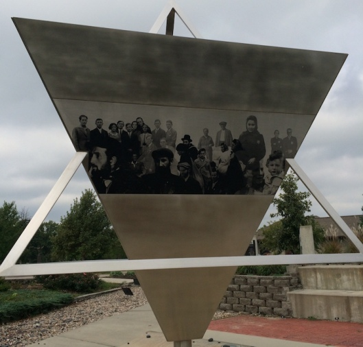 Morton Katz's sculpture combines the symbolism of the triangle, which Jews and other targeted persons were required to wear, and a three dimension- al Star of David, the emblem of Judaism.