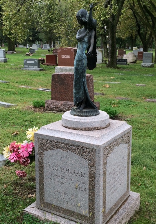 "The grave of Lois ""Toots"" Pegram is marked with a beautiful bronze of a young woman holding a peacock."