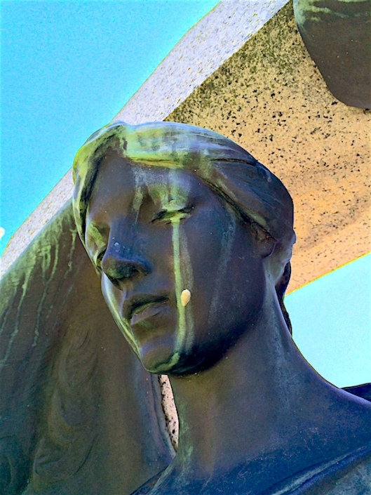 The Learned bronze appears to be weeping.