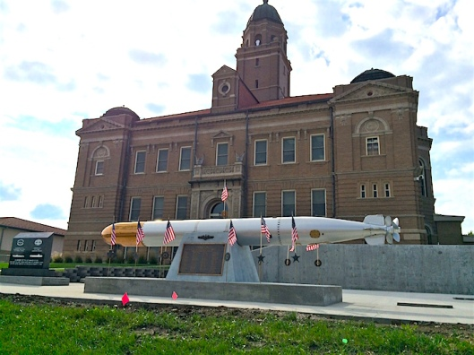 On the lawn of the Saunders County courthouse is a replica of a Mark 14 torpedo memorializes the 65 men who perished when the submarine U.S.S. Wahoo was sunk during enemy action in Sea of Japan during World War II.