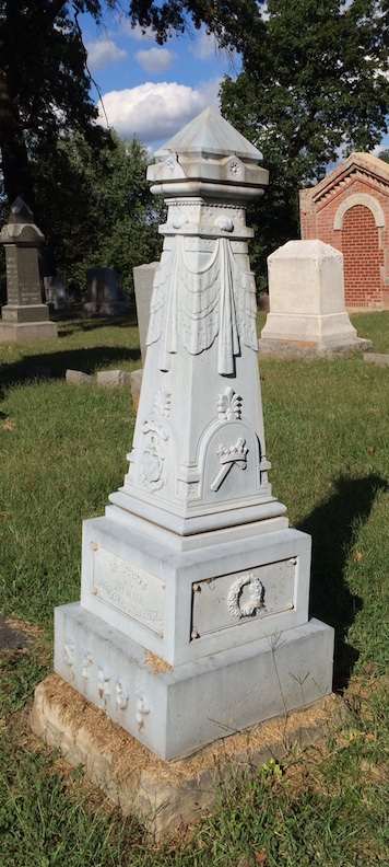 The white bronze monument for William Strop has some uncommon symbols on it.