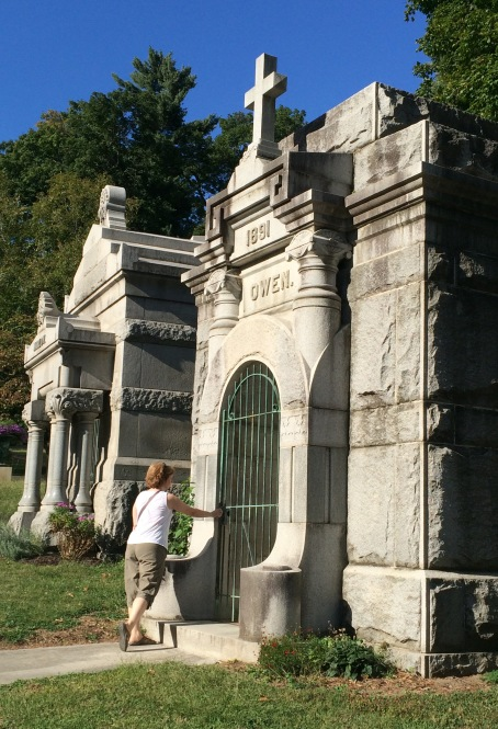 That's Christi standing at the Owen Mausoleum door. For some reason the front bronze grille door was open (but the inner doors were not).