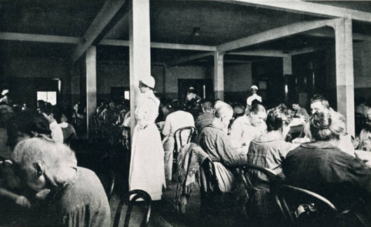 Patients dining at the Norfolk Asylum for the Insane. Year is unknown. Photo source: www.asylumproject.org.
