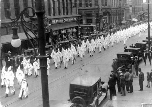 The Klan marches down Denver's Larimer Street on May 31, 1926. Photo source: The Denver Public Library Western History Collection.