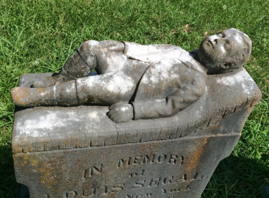 I see a lot of lambs on children's graves but an actual child is more rare.